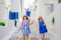 Family vacation in Europe. Father and kids at narrow street on Mykonos Island, in Greece Royalty Free Stock Photos