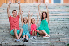 Family vacation in Europe. Parents and kids on steps in Rome Royalty Free Stock Images