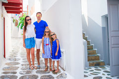 Family vacation in Europe of typical greek traditional village on Mykonos Stock Photo