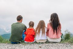 Beautiful happy family in mountains in the background of fog royalty free stock image