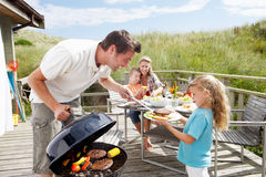 Family on vacation having barbecue. Outside royalty free stock photos