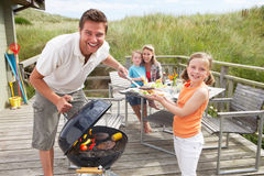 Family on vacation having barbecue. By the beach royalty free stock images