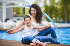 Family On Vacation Having Fun at Outdoor Pool.  Stock Photos