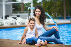 Family On Vacation Having Fun at Outdoor Pool.  Royalty Free Stock Photo