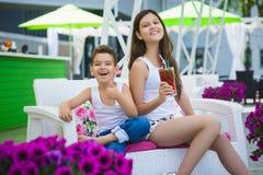 Family On Vacation Having Fun at Outdoor Pool.  Royalty Free Stock Photos