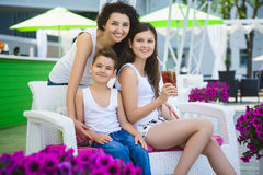 Family On Vacation Having Fun at Outdoor Pool.  Royalty Free Stock Photography