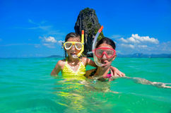 Family vacation, mother and kid snorkeling in sea Stock Photo