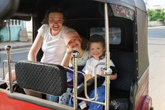 Family on vacation, mother and kids sitting in tuk-tuk, having fun royalty free stock photos
