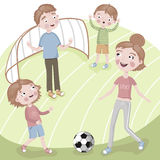 Family on vacation playing football. Family of four playing football on vacation Royalty Free Stock Photography