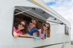 Family vacation, RV (camper) travel with kids. Family vacation, RV travel with kids, happy parents with children on holiday trip in motorhome Royalty Free Stock Image
