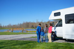 Family vacation, RV travel with kids, happy parents with children have fun and make selfie on holiday trip in motorhome Royalty Free Stock Images