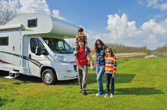 Family vacation, RV travel with kids, happy parents with children on holiday trip in motorhome. Camper exterior Royalty Free Stock Image