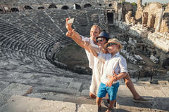 Family vacation selfie photo in antique amphitheater ruins in Si Stock Image