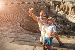 Family vacation selfie photo in anyique amphitheater in Side,Tur Stock Photography