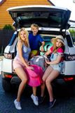 Family vacation suitcases Labrador dog girl boy kid baggage blue pink orange house sun summer luggage car ready holidays green tra. Mother, girl and boy are Stock Photos