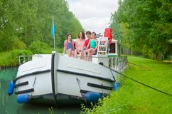 Family vacation, summer holiday travel on barge boat in canal, happy kids and parents having fun on river cruise trip in houseboat. In France stock photo