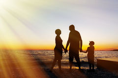 Family vacation. Sunset at sea. Silhouette. Family vacation. Sunset at sea stock images
