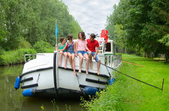 Family vacation, travel on barge boat in canal, happy kids having fun on river cruise trip. In houseboat stock photo