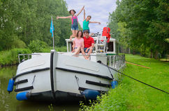 Family vacation, travel on barge boat in canal, parents with kids having fun on river cruise. Family vacation, travel on barge boat in canal, happy parents with royalty free stock photos