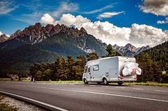 Family vacation travel, holiday trip in motorhome. Caravan car Vacation. Beautiful Nature Italy natural landscape Alps Royalty Free Stock Image