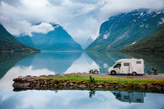 Family vacation travel, holiday trip in motorhome. Caravan car Vacation. Beautiful Nature Italy natural landscape Alps Stock Images