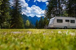 Family vacation travel, holiday trip in motorhome. RV, Caravan car Vacation. Beautiful Nature Italy natural landscape Alps Stock Photography