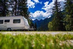 Family vacation travel, holiday trip in motorhome. RV, Caravan car Vacation. Beautiful Nature Italy natural landscape Alps royalty free stock image
