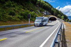 Family vacation travel RV, holiday trip in motorhome. Caravan car Vacation. Beautiful Nature Norway natural landscape. Car in motion blur stock photos