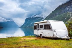 Family vacation travel RV, holiday trip in motorhome. Caravan car Vacation. Beautiful Nature Norway natural landscape royalty free stock photos