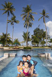 Family vacation in tropical beach. Family vacation in a luxury resort with a big swimming pool Royalty Free Stock Image