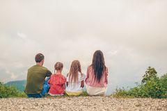 Beautiful happy family in mountains in the background of fog royalty free stock photography