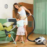 Family with vacuum cleaner Stock Images