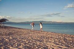 Family and valentines day. woman and man at sea. Summer holidays and travel vacation. Love relations of running. Family and valentines day. women and men at sea royalty free stock photos