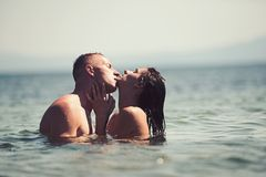 Family and valentines day. Summer holidays and travel vacation. Love relations of kissing couple enjoying summer day. Together. women and men swim in sea water stock photo