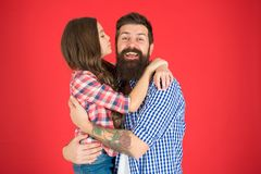 Family values concept. Family bonds. Friendly relations. Father hipster and his daughter. Sweet hug. Man bearded father royalty free stock images