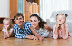 Family values: portrait of parents with little girls indoors Stock Photo