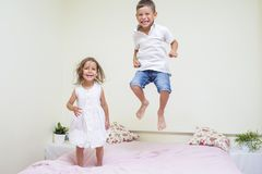Family Values and Relationships. Happy and Excited Kids Playing Indoors Royalty Free Stock Photos