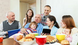 Family  with various electronic communication devices Royalty Free Stock Photo