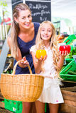Family vegetables grocery shopping in corner shop Stock Image