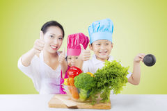 Family with vegetables and thumbs up Stock Photos