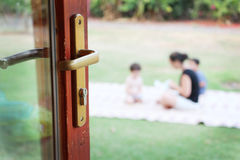 Family viewed through an open door Stock Photo