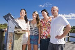 Family on viewing platform by the creek Royalty Free Stock Photography