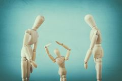family violence cincept. wooden dummies as parents and child arguing and shouting. royalty free stock images