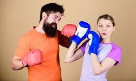 Family violence. Man and woman in boxing gloves. Boxing sport concept. Couple girl and hipster practicing boxing. Sport stock images