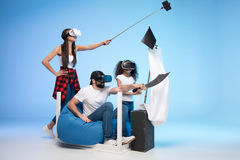 Family in virtual reality headsets pretending being pirates while playing together. Side view of family in virtual reality headsets pretending being pirates Stock Photography