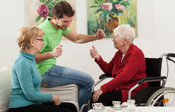 Family visit. Elder disabled person has a family visit Stock Images