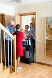 Family visit. Happy family is coming to kinsfolk home Royalty Free Stock Photography