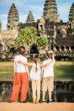 Family at Angkor Wat temple Royalty Free Stock Photos