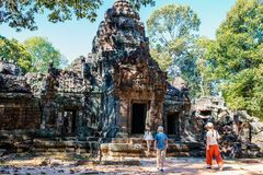 Ta Som temple. Family visiting ancient Ta Som temple in Angkor Archaeological area in Cambodia Royalty Free Stock Photo