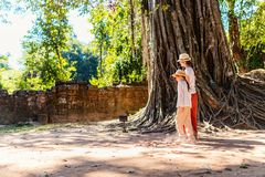 Ta Som temple. Family visiting ancient Ta Som temple in Angkor Archeological area in Cambodia Royalty Free Stock Images